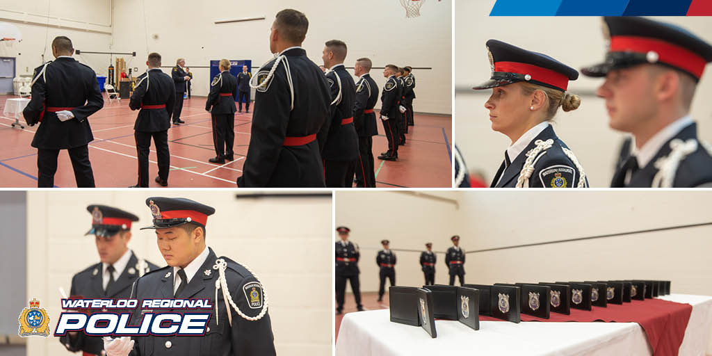 New officers being sworn in, standing in uniform