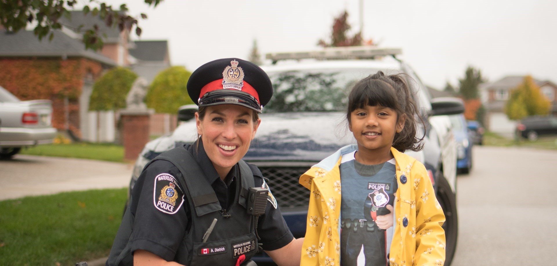 WRPS constable and child in front of cruiser